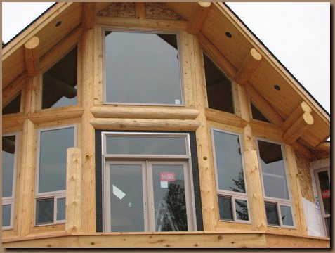 Windows and door installed into log window wall